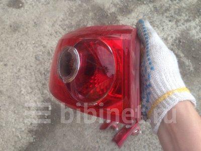 Купить Фонарь стоп-сигнала на Mazda Demio DY3W левый  в Красноярске